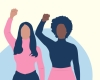 black and brown women with fists raised