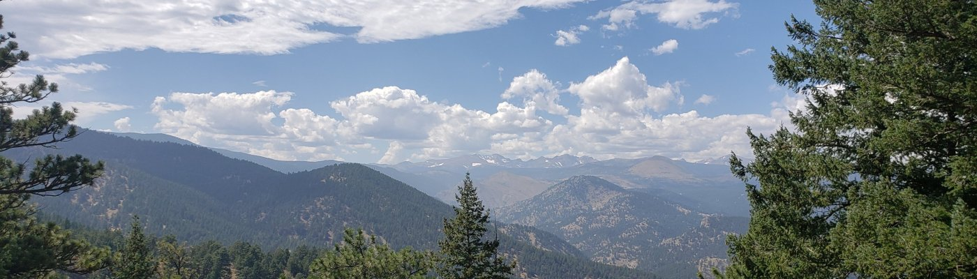 photo of trees, mountains, and clouds